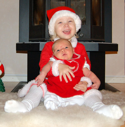 A picture of Emilia and Filippa in Christmas outfits