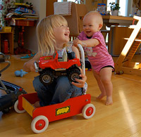 A picture of Filippa pushing Emilia