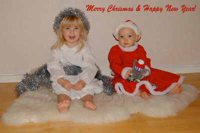 A picture om my daughters wearing Christmas outfits